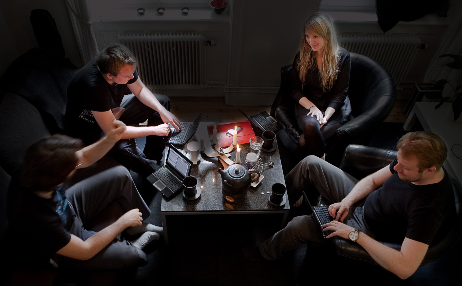 Figure 3: Players and game master engaged in tabletop role-playing using the Undercurrents system.