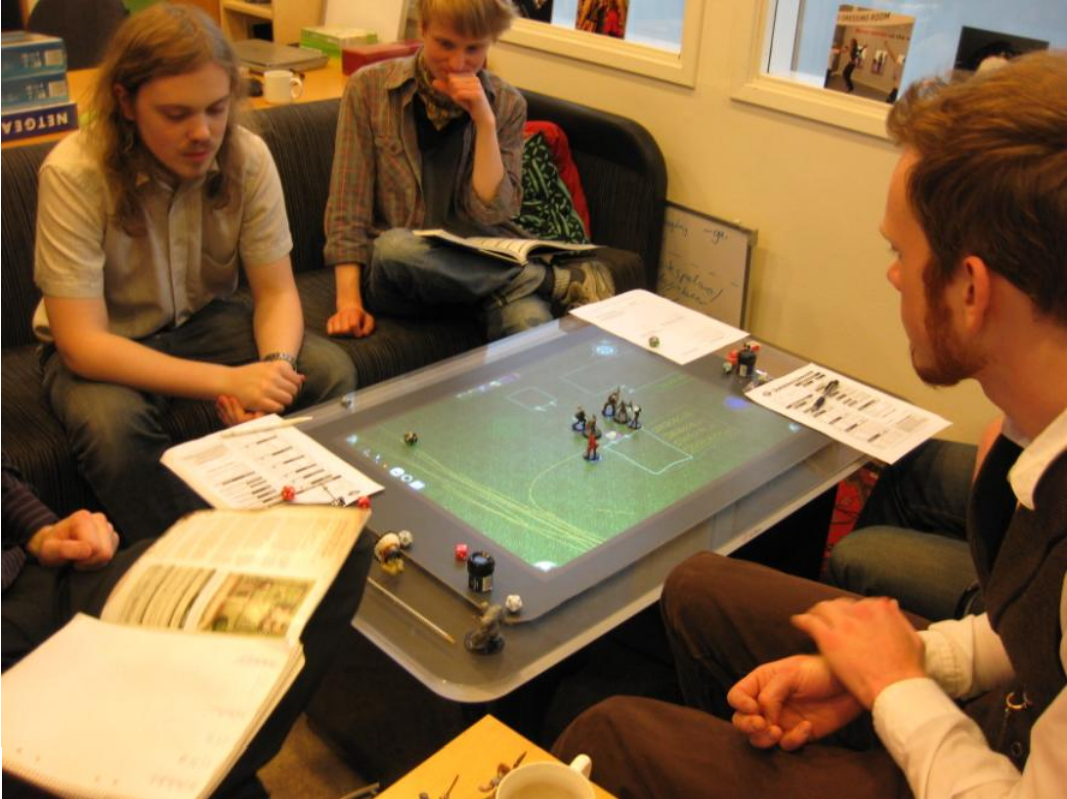 Figure 4: Play testers using Tisch to battle it out in an (not so) abandoned farmyard.