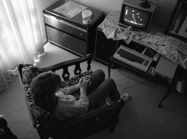 Figure 2: Katie Scott, playing on a Commodore 64 purchased Christmas 1985.